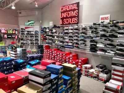 Dupont Circle Cardinal Uniforms & Scrubs Shoe Wall New Balance, Sketchers, Brooks, Asics, Dansko, Sanita, Reebok