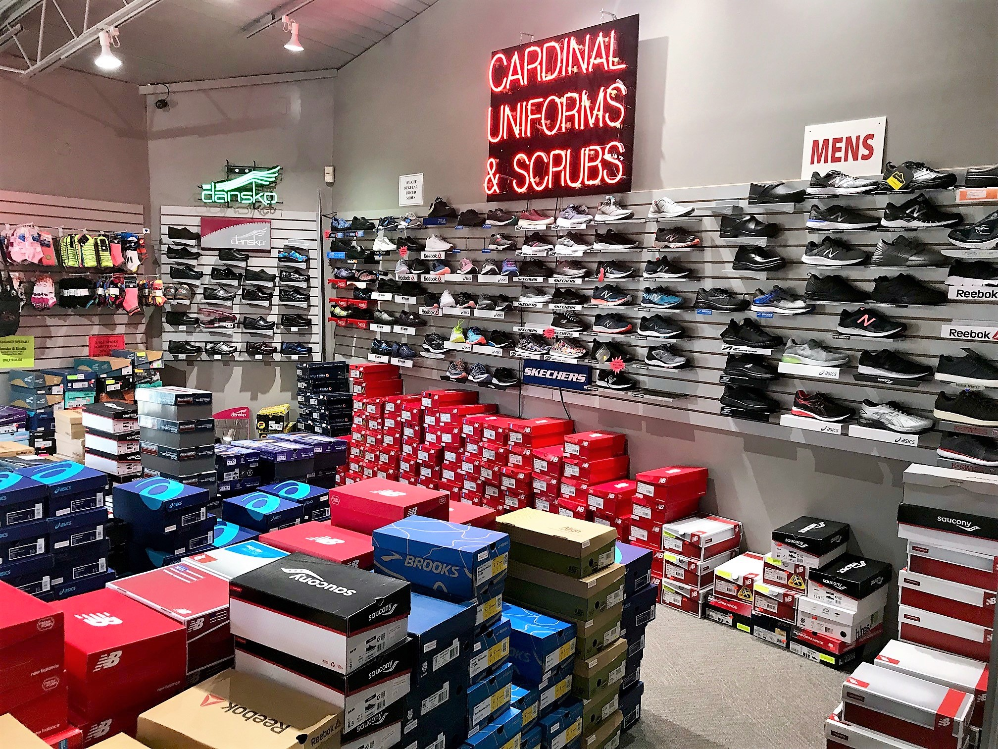 Dupont Circle Cardinal Uniforms & Scrubs Shoe Wall New Balance, Sketchers, Brooks, Asics, Dansko, Sanita, Reebok